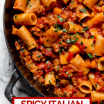 Spicy Italian Sausage & Peppers pasta with graphic text overlay for Pinterest