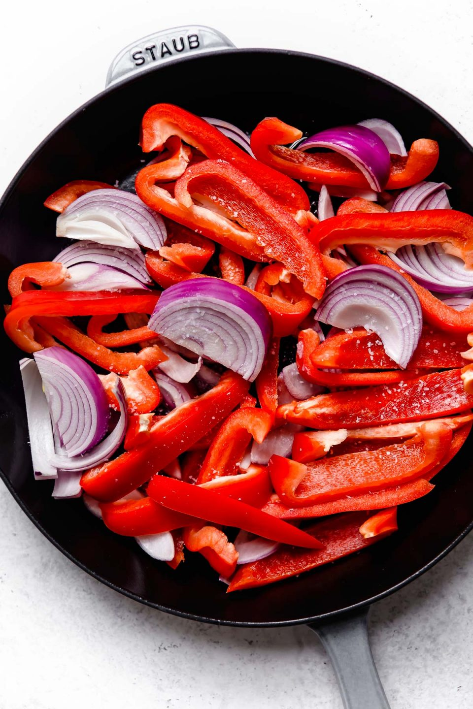 How to make vegetarian red curry step 2: Lightly charring peppers & onions in a skillet.