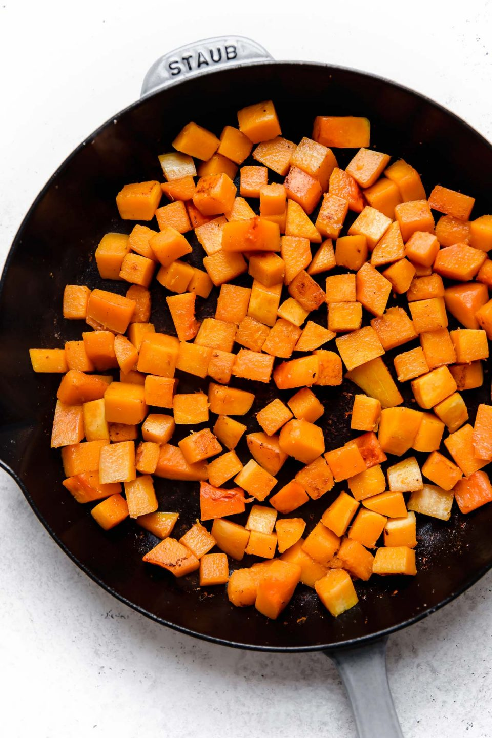 How to make vegetarian red curry step 2: Lightly charring butternut squash in a skillet.