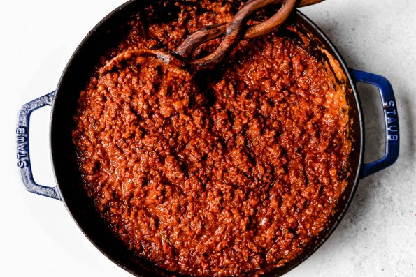 Simmered bolognese sauce in a large black pot.