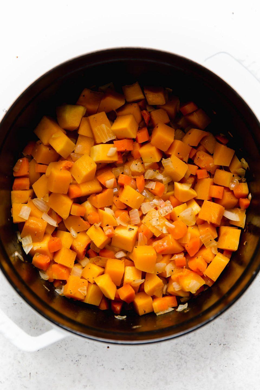 Sauteeing Turmeric Chicken Soup veggies: carrots, onion, & butternut squash.