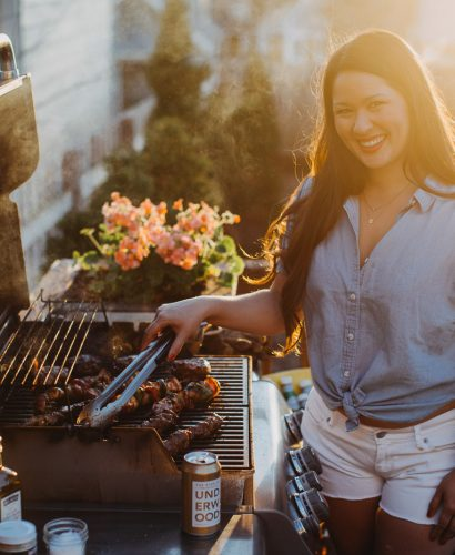 Jess of Plays Well with Butter using grilling equipment to grill kebabs on a gas grill
