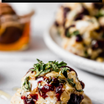 Goat cheese truffles with graphic text overlay for Pinterest.