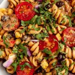 Creamy Vegan Southwest Pasta Salad with graphic text overlay for Pinterest.