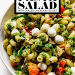 Summer Pesto Pasta Salad with graphic text overlay for Pinterest.