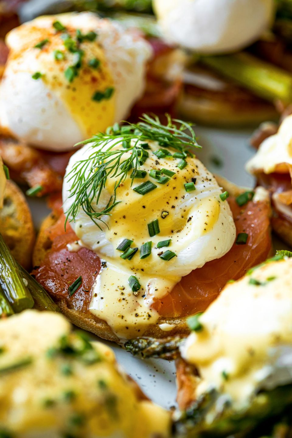 Close up of smoked salmon eggs benedict from the side.
