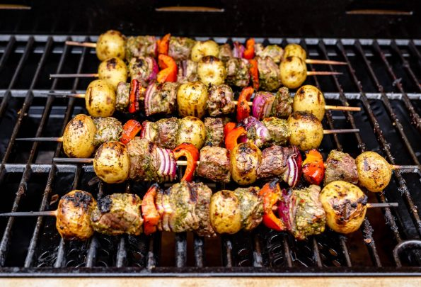 Grilled steak kabobs, Step 4: Grilled steak kabobs shown on grill grates.