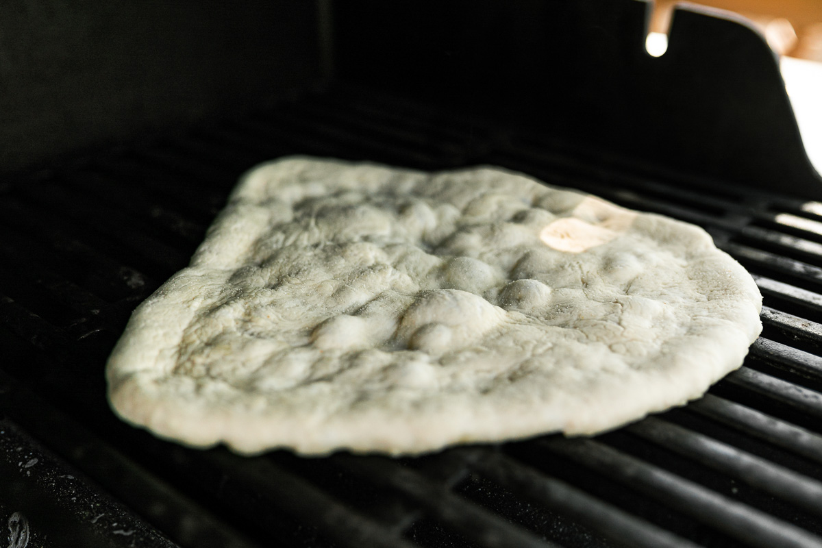 How to grill pizza, Step 4: Par grilled pizza crust on grill grates over direct heat.
