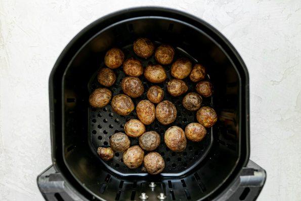 Alexia Ready & Roasted Baby Golden Potatoes inside an Air Fryer basket.