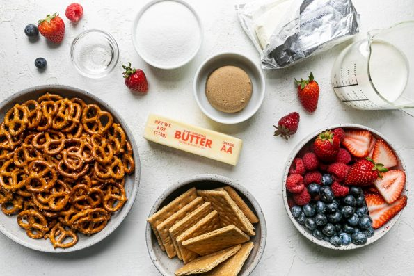 No-Bake Summer Berry Cheesecake Tart with Pretzel Graham Cracker Crust ingredients: pretzel twists, graham crackers, brown sugar, kosher salt, unsalted butter, cold heavy cream, cream cheese, granulated sugar, pure vanilla extract, & fresh berries.